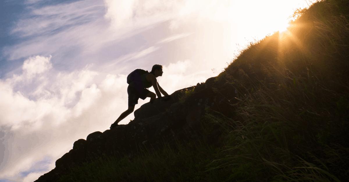 67680-man-climbing-hill-gettyimages-kieferpix
