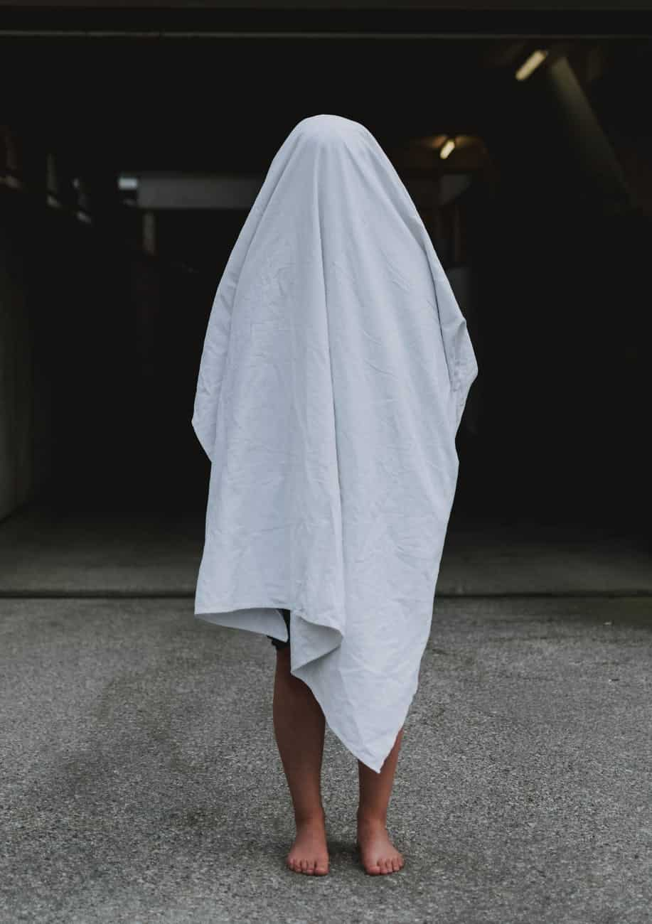 person covered with white cloth