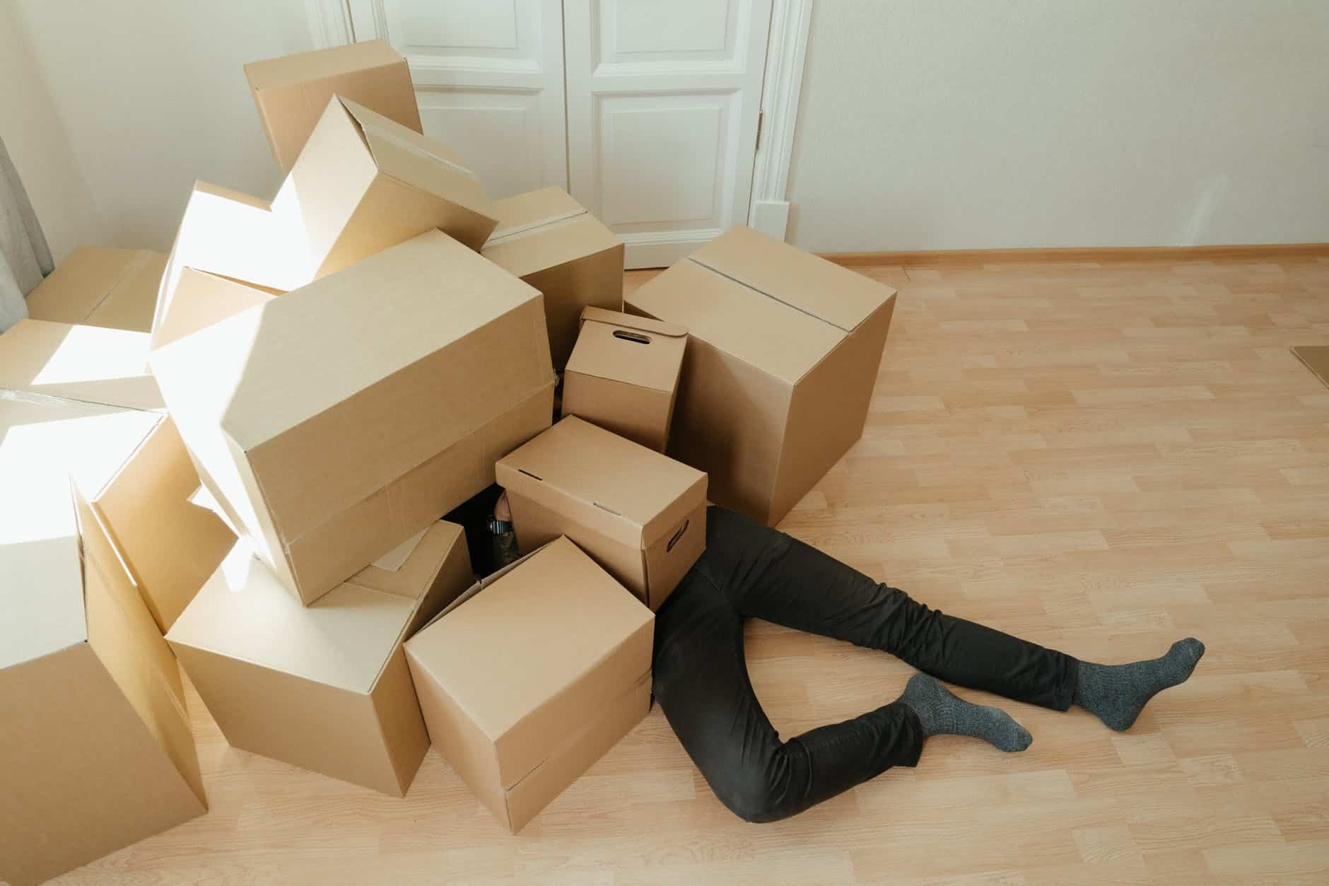 brown cardboard boxes on brown wooden floor