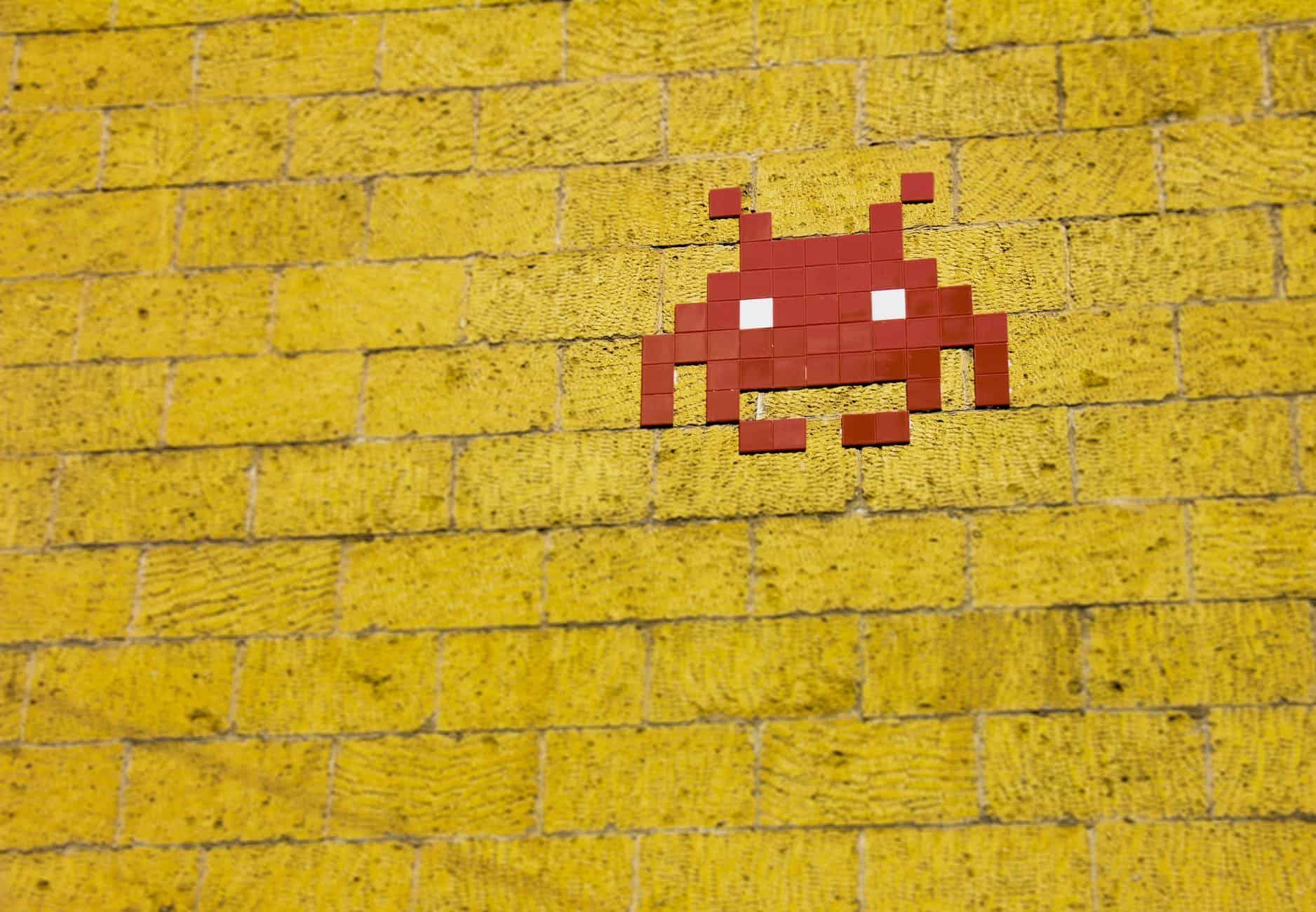 mosaic alien on wall