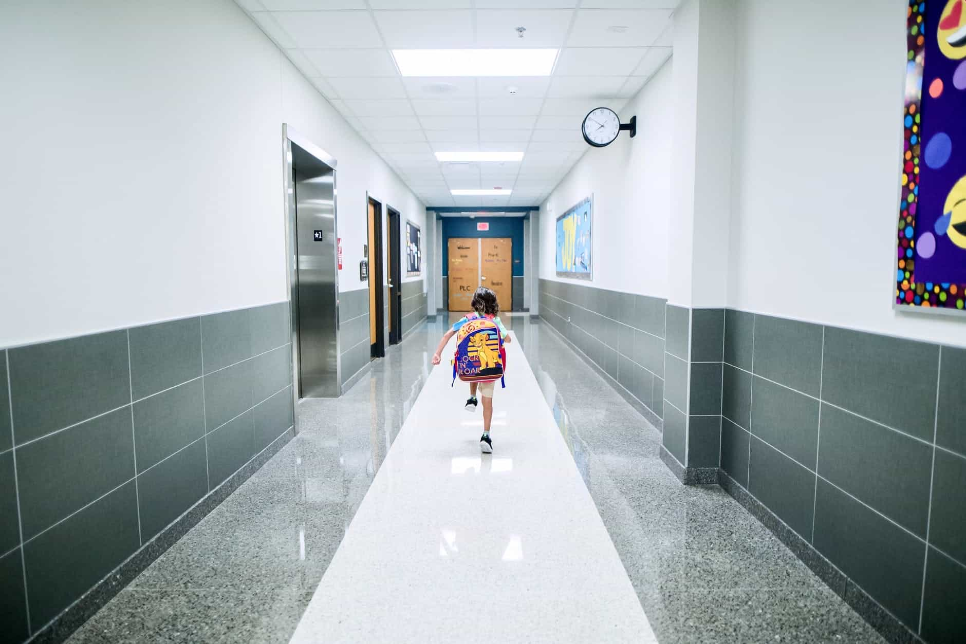 boy running in the hallway