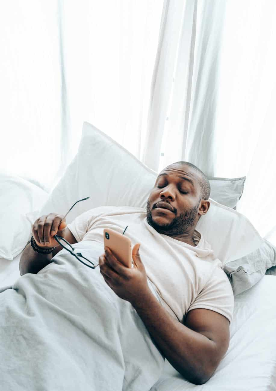 black man waking up from phone call