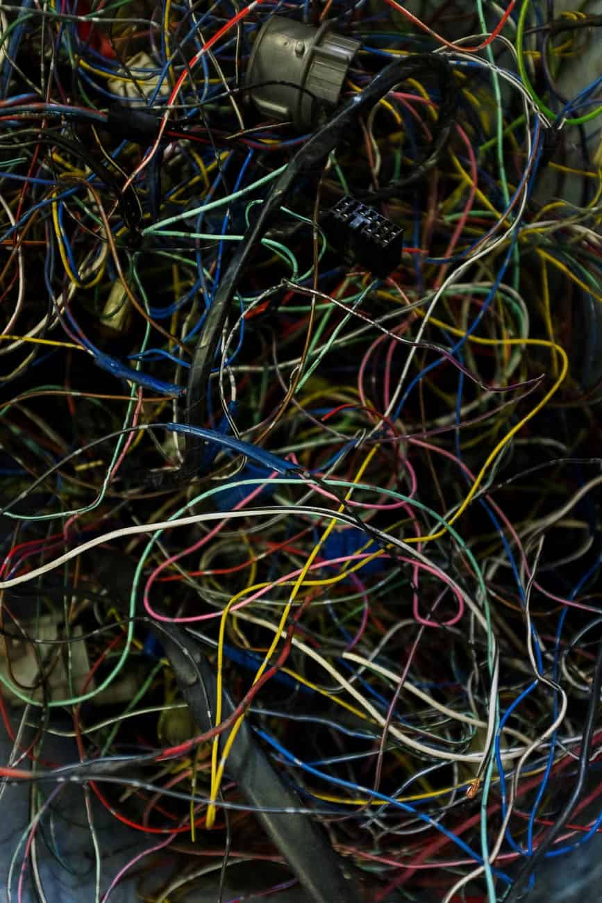 blue yellow and red coated wires representing the change we need to make