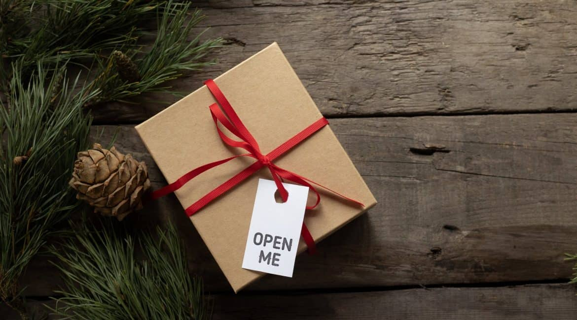 gift box with open me title on tag