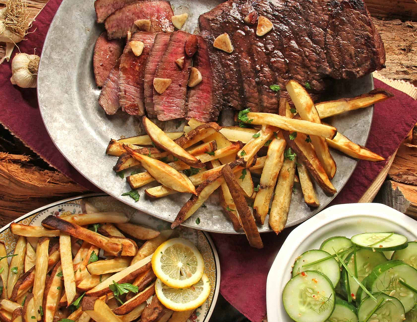 Taking Action to make steak and french fries on gray plate