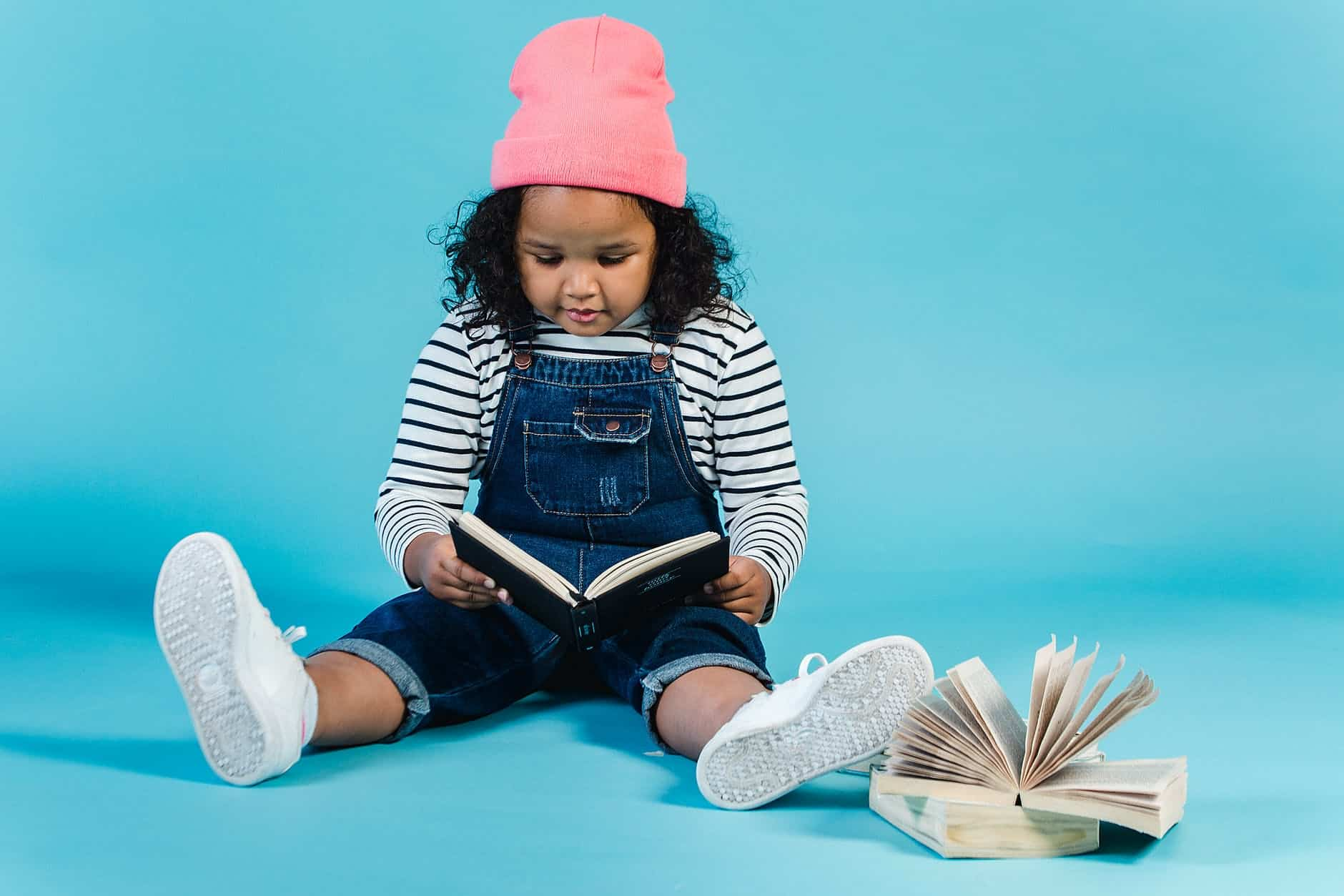 adorable black girl reading interesting book Mastering Your Mind