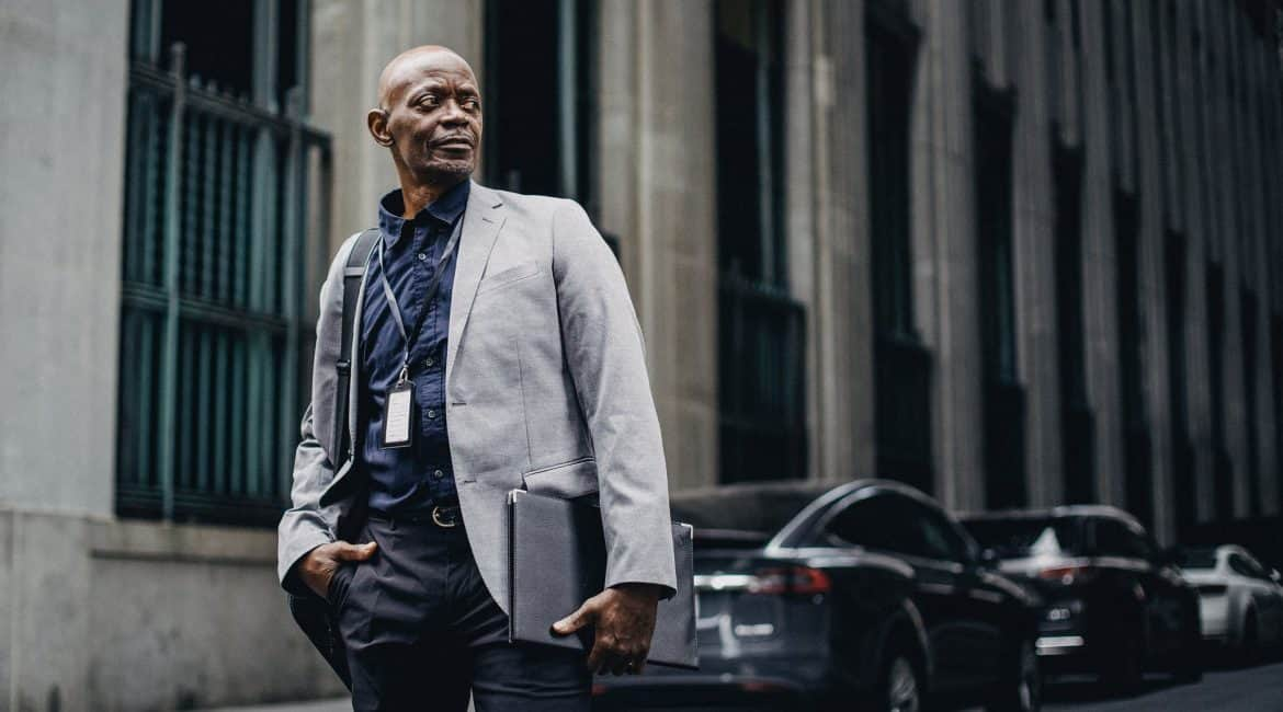 respectable black businessman standing on street