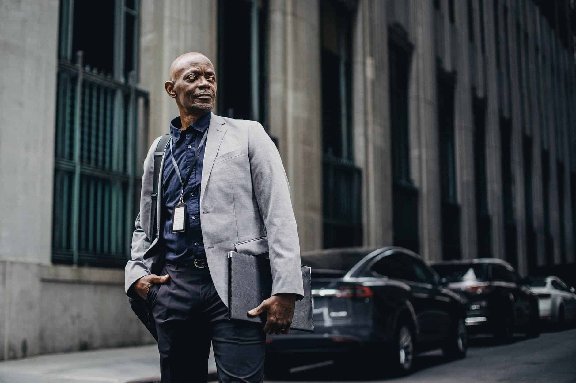 respectable black businessman standing on street The Key to Effective Leadership