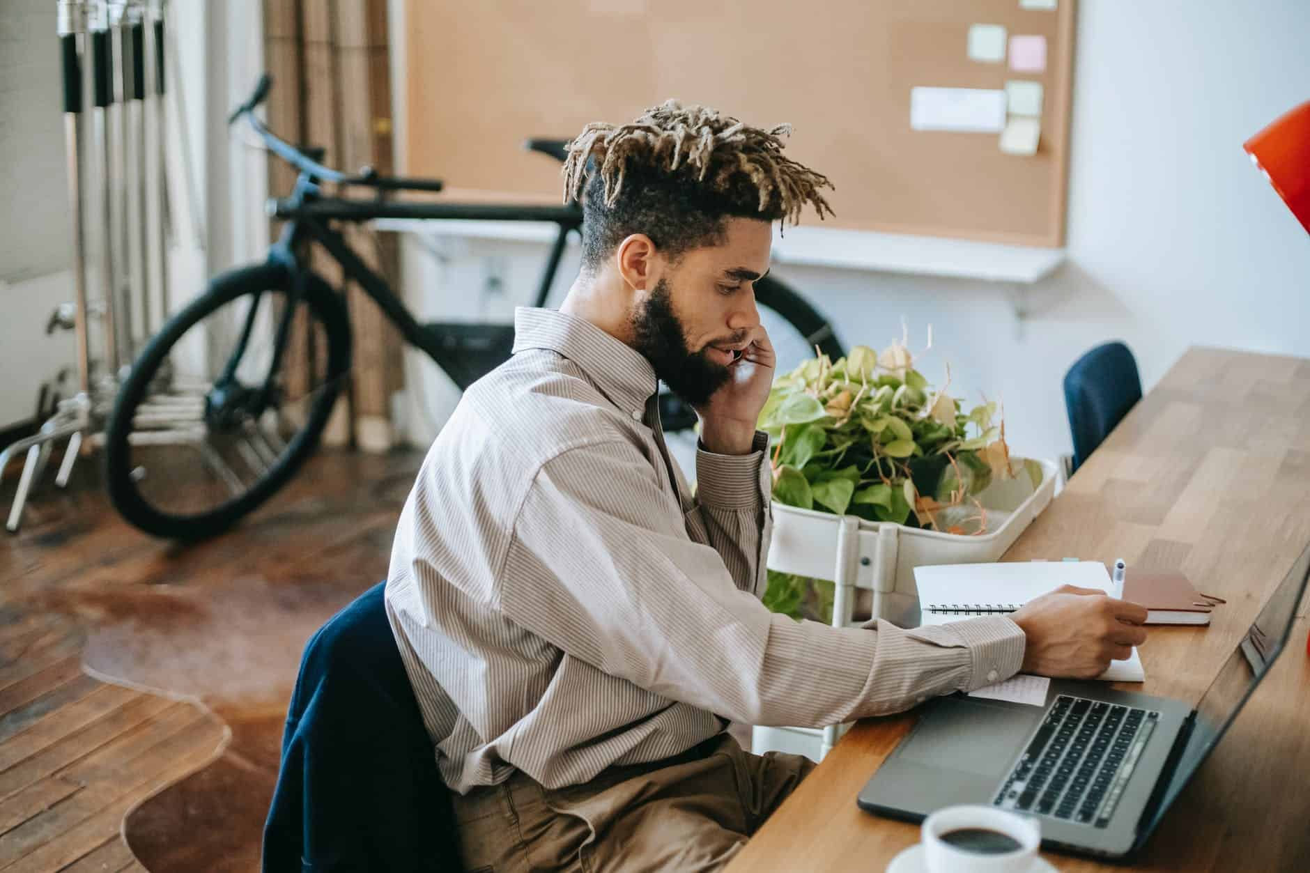 black man working remotely on laptop in workspace Listening to find truth in the silence