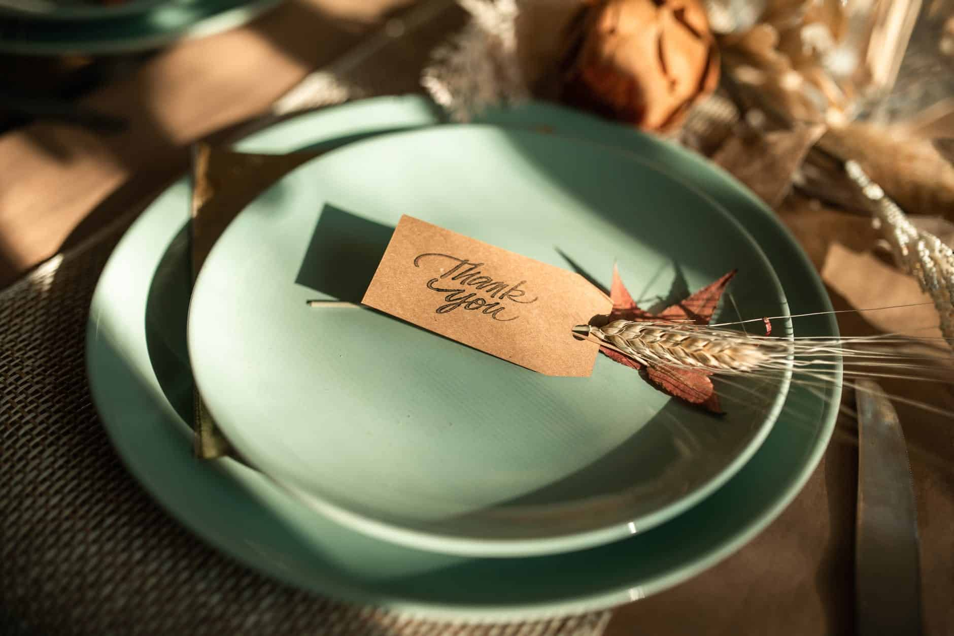 white and brown card on green ceramic round plate Victim Mentality