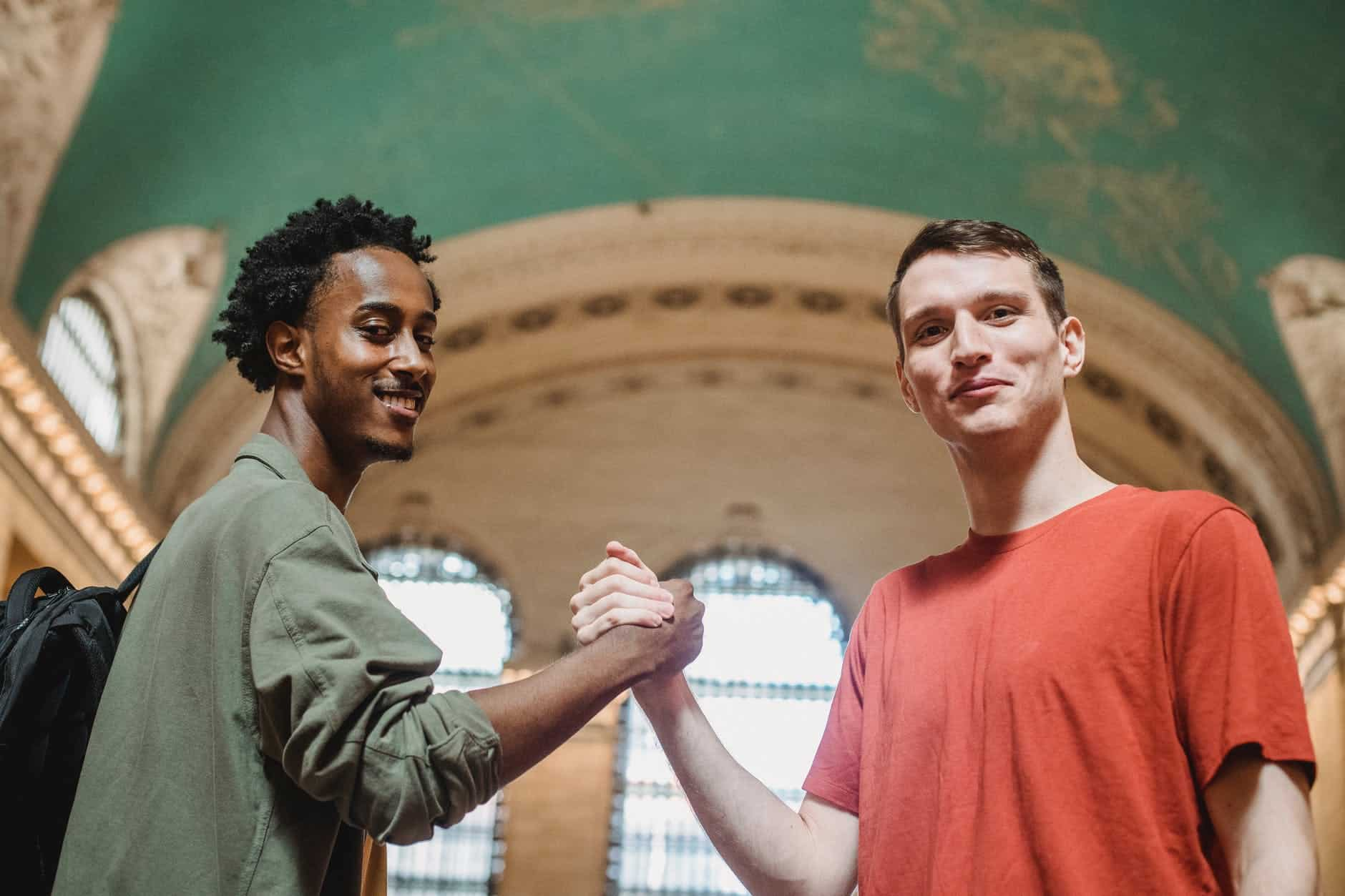 smiling young diverse guys giving diving dap after meeting in aged building Why is Self Awareness So Important For Success?