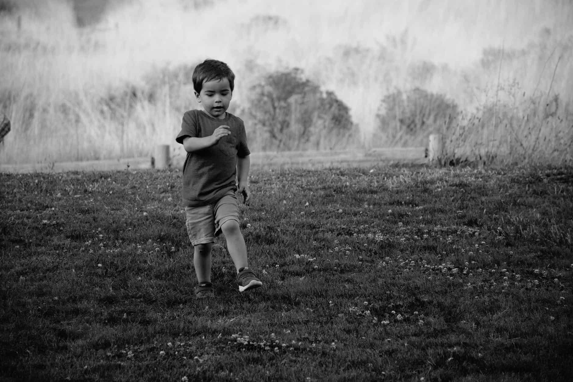 grayscale photography of kid walking on grass The Healing Powers of Micro-Shifting
