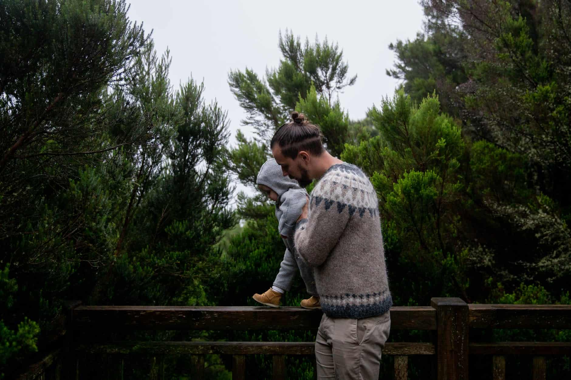 father playing with son in fir forest - mindfulness matters